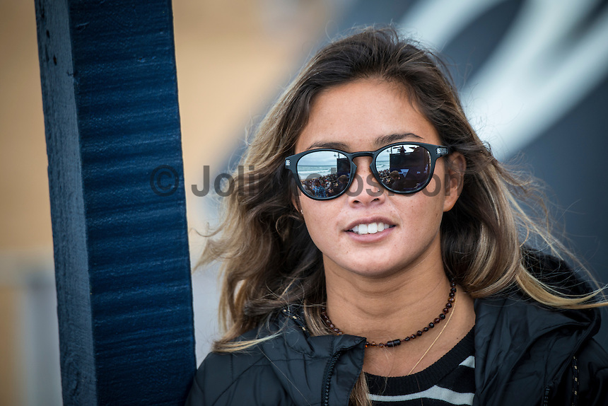 BELLS BEACH, Victoria/AUS (Sunday, March 27, 2016) Alessa Quizon (HAW) - Action at the Rip Curl Pro Bells Beach, the second stop on the World Surf League (WSL) Championship Tour (CT), continued today with Round Two and six heats of Round Three of the Men's heats.<br /> There were light onshore South West winds throughout the day with the swell in the 6'-8' range.<br /> <br /> Bells Beach has been hosting surfing tournaments for more than 50 years now, making it the most renowned spot on the raw and rugged southern coast of Victoria, Australia. The list of  Rip Curl Pro event champions is a veritable who's who of surfing icons, including many world champions.<br /> <br /> Surfing's greats have a way of dominating Bells. Mark Richards, Kelly Slater, and Mick Fanning all have four Bells trophies; Michael Peterson and Sunny Garcia, three; While Simon Anderson, Tom Curren, Joel Parkinson, Andy Irons, and Damien Hardman each grabbed a pair.<br /> <br /> The story is similar on the women's side. Lisa Andersen and Stephanie Gilmore have four Bells titles; Layne Beachley and Pauline Menczer, three; while Kim Mearig and Sally Fitzgibbons each have two.<br /> <br /> The 2016 event is about to kick off tomorrow and there was a packed warm up session at Bells this morning. <br /> Photo: joliphotos.com