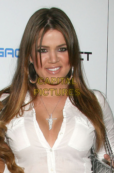 KHLOE KARDASHIAN.Khloe Kardashian, the night before she has to start her sentence of 30 days in jail for DUI. 2nd Annual Matt Leinart Celebrity Bowling Night held at Lucky Strike Lanes, Hollywood, California, USA..July 17th, 2008.headshot portrait white necklace earrings silver hoop .CAP/ADM/MJ.©Michael Jade/AdMedia/Capital Pictures.