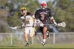Palos Verdes, CA 03/30/10 - Hunter Grasinger (Peninsula #17) and Roman Smith (Palos Verdes #3) in action during the Palos Verdes-Peninsula JV Boys Lacrosse game.