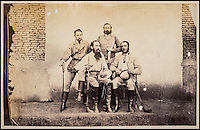 BNPS.co.uk (01202 558833)<br /> Pic: DominicWinter/BNPS<br /> <br /> Photographer Samuel Bourne (front left)<br /> <br /> Fascinating 150 year-old photographs of India taken in the aftermath of the failed mutiny have sold for almost &pound;8,000 at auction.<br /> <br /> The images, which date from 1863 to 1870, capture native soldiers with their weapons and picturesque landscapes and were taken by celebrated 19th century photographer Samuel Bourne.<br /> <br /> They went for a hammer price of &pound;6,400 to a private collector from America who bid online with extra fees pushing the overall price above &pound;7,800.<br /> <br /> Together with Charles Shepherd, Bourne set up photo studio Bourne &amp; Shepherd first in Simla in 1863 and later in Calcutta.