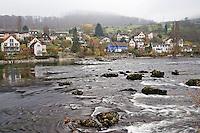 Typical Swiss homes along Rhein River on foggy autumn day, Schaffhausen, Switzerland