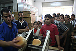 Palestinians queue in a crowd at oven, in Gaza City. Gaza reeled from power outages today as Israel continued to seal off the Hamas-run territory. Bakeries across Gaza City were closing today for lack of electricity to power their ovens.