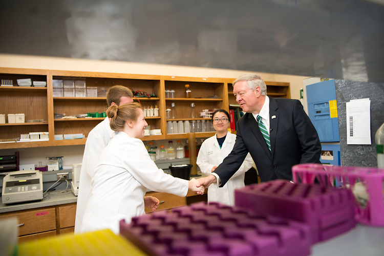 President Nellis greets students and faculty at the Edison Biotechnology Institute during his first day in office.