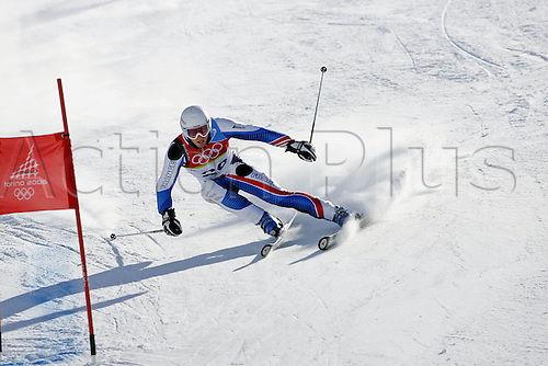 20 February 2006: French skier Joel Chenal (FRA) rounds a gate during his first run in the Men's Giant Slalom at the Sestriere sub-area Colle during the 2006 Turin Winter Olympics. Chenal finished in 2nd place. Photo: Neil Tingle/actionplus..060220 torino male man men ski skiing snow