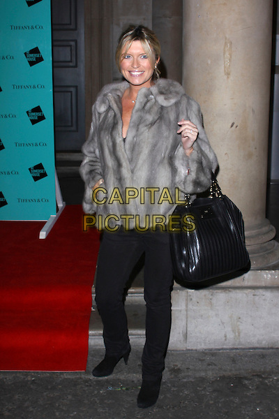 TINA HOBLEY.Tiffany & Co. presents Skate at Somerset House, VIP Opening of the 10th Annual Somerset House Ice Rink, London, England..November 16th, 2009.full length black jacket coat grey gray fur bag purse  jeans denim.CAP/AH.©Adam Houghton/Capital Pictures.