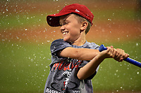 Batavia Muckdogs on field promotion breaking water balloons in between innings during a game against the Mahoning Valley Scrappers on August 30, 2017 at Dwyer Stadium in Batavia, New York.  Batavia defeated Mahoning Valley 5-1.  (Mike Janes/Four Seam Images)
