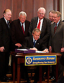 Washingon, D.C. - April 20, 2005 -- United States President George W. Bush makes remarks and signs the Bankruptcy Reform Bill in Washington, D.C. on April 20, 2005.  From left to right behind President Bush: United States Representative Steve Chabot (Republican from Ohio); Speaker of the United States House of Representatives J. Dennis Hastert (Republican of Illinois); United States Representative James Sensenbrenner (Republican of Wisconsin); United States Senator Charles Grassley (Republican of Iowa); and United States Senator Mitch McConnell (Republican of Kentucky).<br /> Credit: Ron Sachs - Pool