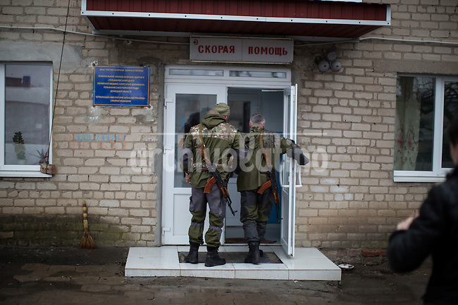 Soldiers patrol while others carry medicines in the eastern Ukraine town of Chimarik, near the city of Mariupol, one of the targets of the pro Russian groups trying to seize control of the region.