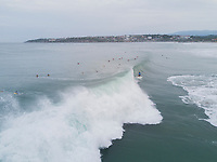 Surfers and boogie boarders in Zicatela beach, Puerto Escondido, Oaxaca, Mexico
