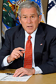 Washington, D.C. - July 11, 2008 -- United States President George W. Bush meets with members of his Economic Team to look for ways to lessen the impact of high gasoline and energy prices on American consumers and businesses at the United States Department of Energy in Washington, DC on Friday, July 11, 2008.  He also spoke concerning discussions about the problems of mortgage lenders Freddie Mac and Fannie Mae<br /> Credit: Ron Sachs / Pool via CNP