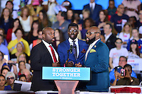 CORAL SPRINGS, FL - SEPTEMBER 30: Singers Frantz Cerant, Sandy Pierre and Hollando Mathurin of Supremacy Vocal Group sing the U.S.National Anthem before the arrival of Democratic presidential candidate Hillary Clinton campaign rally at Coral Springs Gymnasium on September 30, 2016 in Coral Springs, Florida. Clinton continues to campaign against her Republican opponent Donald Trump before election day on November 8th. Credit: MPI10 / MediaPunch