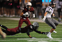 NWA Democrat-Gazette/ANDY SHUPE<br /> Bruce Armstrong (2) of Fayetteville escapes the grasp of Jayden Minchew (left) of Springdale Friday, Oct. 9, 2015, during the first half of play at Jarrell Williams Bulldog Stadium in Springdale. Visit nwadg.com/photos to see more photographs from the game.