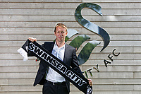 Pictured: Graham Potter holds a team scarf. Monday 11 June 2018<br /> Re: Graham Potter is announced as the new manager for Swansea City AFC at the Fairwood Training Ground, south Wales, UK.