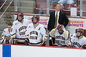 Adam Reasoner 30, Tim Filangieri 5, Mike Brennan 4 and Brian O'Hanley 23 watch play while Brett Motherwell 8 and Assistant Coach Greg Brown are distracted on the Boston College bench. The Eagles of Boston College defeated the Falcons of Bowling Green State University 5-1 on Saturday, October 21, 2006, at Kelley Rink of Conte Forum in Chestnut Hill, Massachusetts.<br />