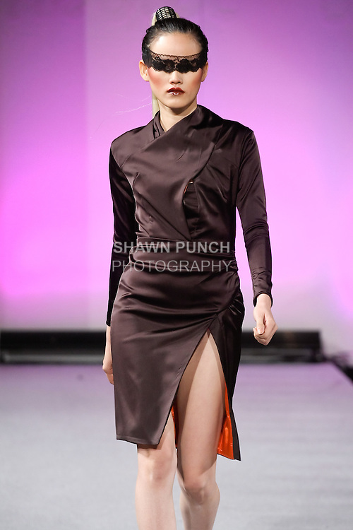 Tuyết Lan, Vietnam's Next Top Model 2010, walks the runway in an outfit from the Edwing D'Angelo Fall 2012 Beauty Attack collection, during Couture Fashion Week New York, February 19, 2012.