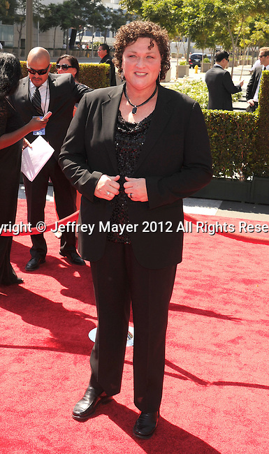 LOS ANGELES, CA - SEPTEMBER 15: Dot Marie Jones arrives at the 2012 Primetime Creative Arts Emmy Awards at Nokia Theatre L.A. Live on September 15, 2012 in Los Angeles, California.