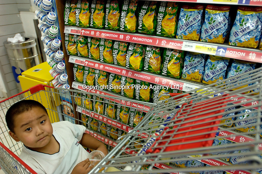 Nestle lemon tea products are on sale with a promotion in a Carrefour supermarket in Beijing, China. Major international chains like Carrefour and Walmart Stores have expanded aggressively in China. Local Chinese retailers have loudly protested this and lobbied heavily for protection from the new competition in price and service that these major retailers have set off..22 Jul 2006