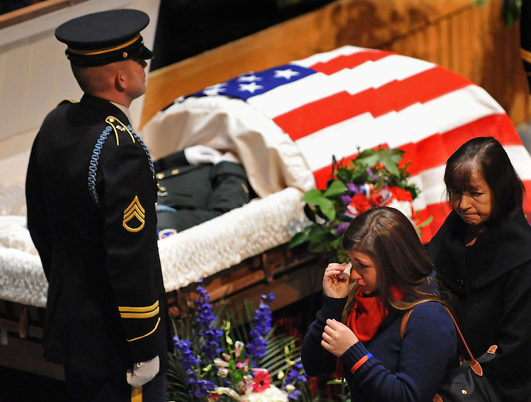 Mourners attend a wake for Army Lt. Scott Milley at Lincoln-Sudbury High School on Friday, December 10, 2010. The Sudbury soldier was killed during his first month of deployment while on patrol outside Baraqi, Afghanistan.