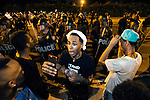 BATON ROUGE, LA -JULY 08:  One of the protesters streams live video as they face off with Baton Rouge police  about the Alton Sterling shooting in Baton Rouge, Louisiana July 8, 2016.  Sterling was shot and killed by police on July 5, 2016 in Baton Rouge, Louisiana. (Photo by Mark Wallheiser/Getty Images)