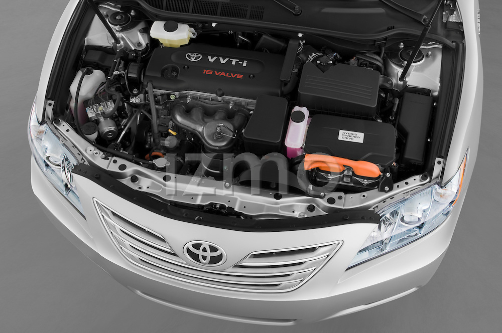 High angle engine detail of a 2009 Toyota Camry Hybrid .