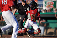 Batavia Muckdogs catcher Pablo Garcia (4) receives a throw in front of home plate umpire Tyler Witte during a game against the West Virginia Black Bears on July 3, 2018 at Dwyer Stadium in Batavia, New York.  Batavia defeated West Virginia 5-4.  (Mike Janes/Four Seam Images)