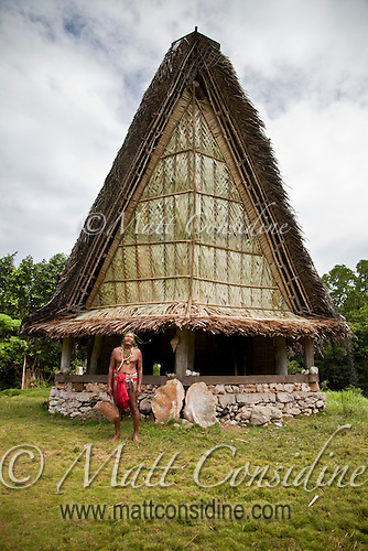 Local village chief outside a traditional men's house in Yap. Men and women sometimes gather in their own separate communal housing during the day. The traditional house is a key instrument to the passing of skills and culture from one generation to another. The men and young boys gather here and fishing and building skills are learned and discussed, Yap Micronesia. (Photo by Matt Considine - Images of Asia Collection) (Matt Considine)