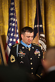 Sergeant First Class Leroy Arthur Petry, U.S. Army, bows his head for prayer during a ceremony to award him the Medal of Honor for conspicuous gallantry and intrepidity at the risk of his life above and beyond the call of duty in the East Room of the White House in Washington D.C., July 12, 2011.  Sergeant Petry, who lost his right hand to a grenade, is receiving the medal for his courageous actions during combat operations against an armed enemy in Paktya, Afghanistan in May, 2008 and is the second living, active duty service member to be awarded the Medal of Honor for actions in Iraq or Afghanistan. .Credit: Allison Shelley / Pool via CNP
