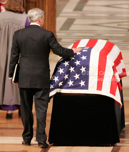 Washington, D.C. - January 2, 2007 -- Tom Brokaw touches the casket of former President Gerald R. Ford during a State Funeral service at the Washington National Cathedral in Washington, Tuesday, January 2, 2007. <br /> Credit: Pablo Martinez Monsivais-Pool via CNP