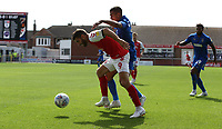 Fleetwood Town's Ched Evans shields the ball from Wimbledon's Tennai Watson<br /> <br /> Photographer Stephen White/CameraSport<br /> <br /> The EFL Sky Bet League One - Fleetwood Town v AFC Wimbledon - Saturday 4th August 2018 - Highbury Stadium - Fleetwood<br /> <br /> World Copyright &copy; 2018 CameraSport. All rights reserved. 43 Linden Ave. Countesthorpe. Leicester. England. LE8 5PG - Tel: +44 (0) 116 277 4147 - admin@camerasport.com - www.camerasport.com