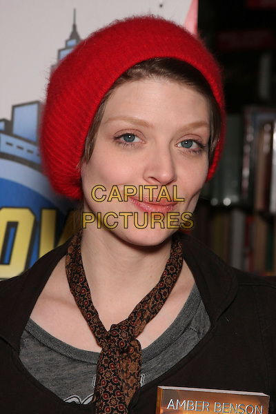 "AMBER BENSON.at the Book Signing for ""Cat's Claw"" at Midtown Comics Times Square, New York, NY, USA, .February 27th, 2010..portrait headshot brown scarf  red hat beanie .CAP/LNC/TOM.©LNC/Capital Pictures"