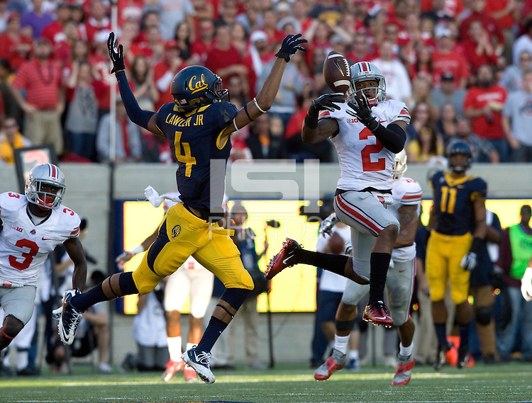 Christian Bryant of Ohio State unable to intercept the ball away from Kenny Lawler of California during the game at Memorial Stadium in Berkeley, California on September 14th, 2013.  Ohio State defeated California, 52-34.