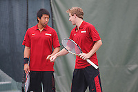 STANFORD, CA -- March 7, 2013: Denis Lin and John Morrissey during Stanford vs Furman doubles play Thursday afternoon at Taube Family Tennis Stadium.<br /> <br /> Stanford won 7-0.