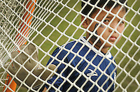 "Kelly.Jordan@jacksonville.com--111911--Thanaung Soe, 9, of Burma looks through the net of the goal he is defending for his soccer game during the ""Kickin' It For Refugees"" Soccer Fun Day on the UNF campus Saturday November 19, 2011. The soccer fun day is an opportunity for the UNF community to welcome 80 refugee children and their families to campus in the spirit of celebrating the children's academic and personal achievements. UNF departments, student clubs and local businesses that participated in donating items to the refugee families will be recognized at the event. This event is a part of the UNF Reads! Program and is co-sponsored by the Honors Program.(The Florida Times-Union, Kelly Jordan)"