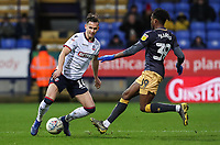 Bolton Wanderers' Pawel Olkowski competing with Sheffield Wednesday's Rolando Aarons <br /> <br /> Photographer Andrew Kearns/CameraSport<br /> <br /> The EFL Sky Bet Championship - Bolton Wanderers v Sheffield Wednesday - Tuesday 12th March 2019 - University of Bolton Stadium - Bolton<br /> <br /> World Copyright © 2019 CameraSport. All rights reserved. 43 Linden Ave. Countesthorpe. Leicester. England. LE8 5PG - Tel: +44 (0) 116 277 4147 - admin@camerasport.com - www.camerasport.com