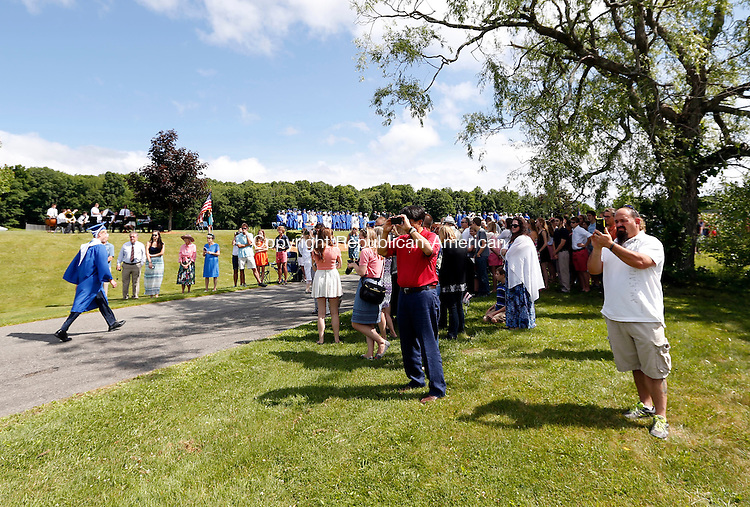 Washington, CT- 13 June 2015-061315CM04-  Shepaug Valley High School  graduates make their way through commencement exercises at the high school on Saturday.   Christopher Massa Republican-American