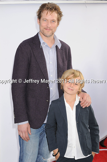 "HOLLYWOOD, CA - SEPTEMBER 25: James Tupper and son Atlas attend Premiere Of ""Iris"" - A Journey Into The World Of Cinema By Cirque du Soleil at the Kodak Theatre on September 25, 2011 in Hollywood, California."