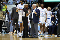 CHAPEL HILL, NC - MARCH 03: Head coach Roy Williams of the University of North Carolina argues with official Jeffrey Anderson during a game between Wake Forest and North Carolina at Dean E. Smith Center on March 03, 2020 in Chapel Hill, North Carolina.