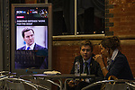 "© Joel Goodman - 07973 332324 . No syndication permitted . 30/09/2013 . Manchester , UK . Preview of George Osborne speech - "" Work for the Dole "" on a screen as delegates have morning coffee . Products for sale in the exhibition this morning (Monday 30th September 2013) . Day 2 of the Conservative Party Conference 2013 at Manchester Central . Photo credit : Joel Goodman"