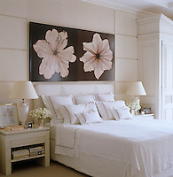 In the master bedroom an unusual lacquered photograph by Adrien Linford hangs above the elegantly dressed bed