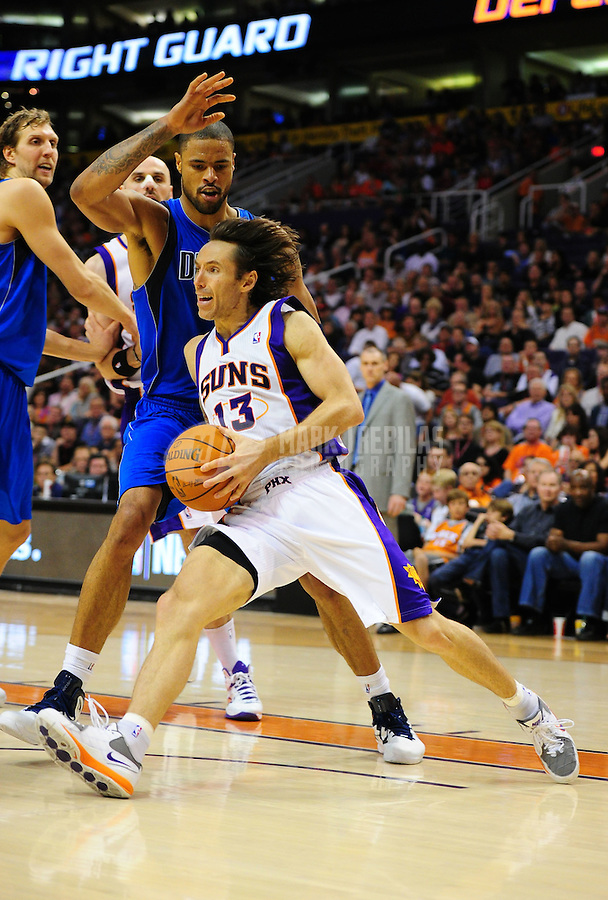 Mar. 27, 2011; Phoenix, AZ, USA; Phoenix Suns guard (13) Steve Nash drives to the basket against Dallas Mavericks center (6) Tyson Chandler at the US Airways Center. The Maverick defeated the Suns 91-83. Mandatory Credit: Mark J. Rebilas-
