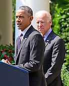 United States President Barack Obama, accompanied by U.S. Vice President Joseph Biden, announces the restoration of formal diplomatic relations with the island nation of Cuba in the Rose Garden of the White House in Washington, D.C. on Wednesday, July 1, 2015.<br /> Credit: Ron Sachs / Pool via CNP