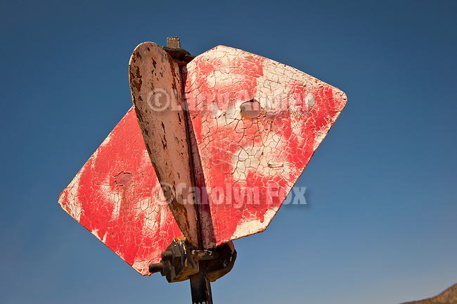 Round and diamond, weatherd red switch signal flag, Nevada Northern Railway, East Ely yards, Nev.