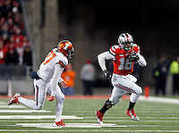 Ohio State Buckeyes quarterback J.T. Barrett (16) gets away from Illinois Fighting Illini defensive back Eaton Spence (27) in the first quarter of the NCAA football game at Ohio Stadium on Saturday, November 1, 2014. (Columbus Dispatch photo by Jonathan Quilter)