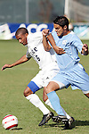 13 November 2005: Duke's Zach Pope (left) holds off North Carolina's Adam Sloustcher (right). Duke University defeated the University of North Carolina 5-4 in penalty kicks following a 0-0 draw at SAS Stadium in Cary, North Carolina in the final of the 2005 ACC Men's Soccer Championship.