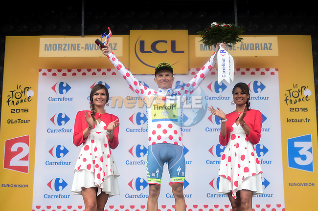Rafal Majka (POL) Tinkoff holds onto the Polka Dot Jersey on the podium at the end of Stage 20 of the 2016 Tour de France running 146.5km from Meg&egrave;ve to Morzine-Avoriaz, France. 23rd July 2016.<br /> Picture: ASO/A.Broadway | Newsfile<br /> <br /> <br /> All photos usage must carry mandatory copyright credit (&copy; Newsfile | ASO/A.Broadway)
