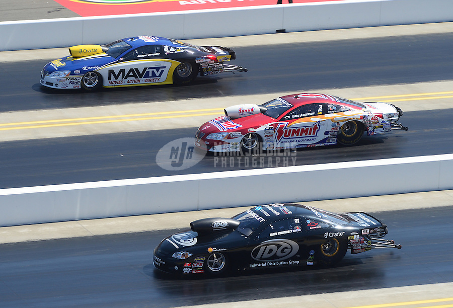 Apr. 14, 2012; Concord, NC, USA: NHRA pro stock drivers Rodger Brogdon (top), Greg Anderson (center) and Dave Connolly during qualifying for the Four Wide Nationals at zMax Dragway. Mandatory Credit: Mark J. Rebilas-