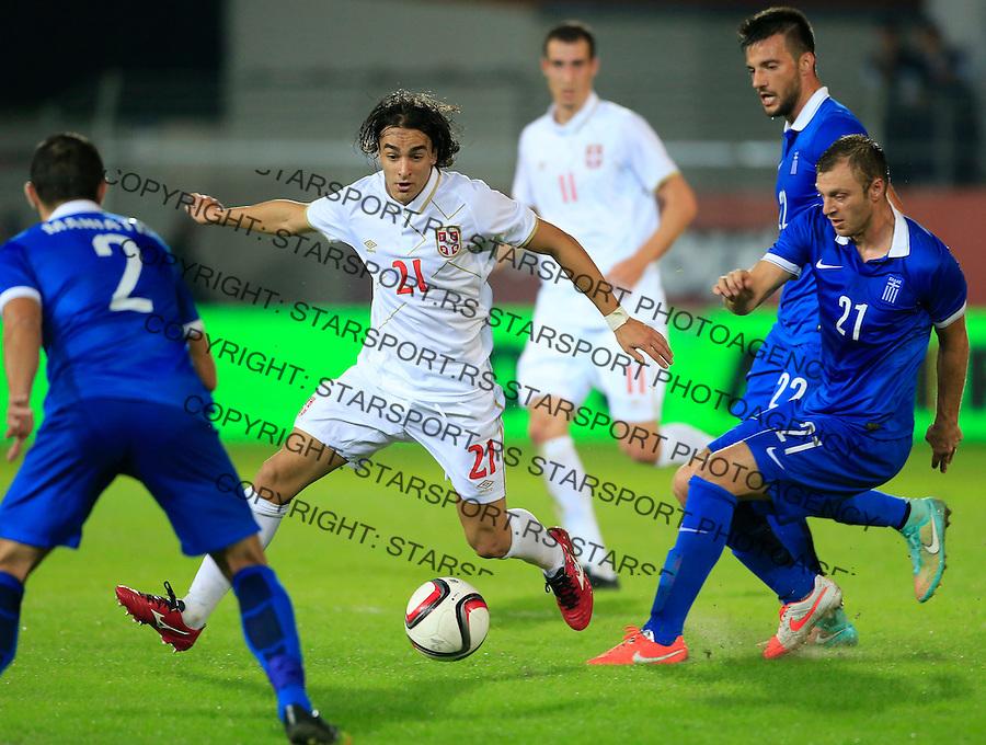 Fudbal<br /> Prijateljski mec-Friendly match<br /> Srbija v Grcka<br /> Lazar Markovic (L) and Avraam Papadopoulos<br /> Chania, 18.11.2014.<br /> foto: Srdjan Stevanovic/Starsportphoto &copy;