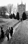 Upper Slaughter, Gloucestershire 1975. England. Church Sunday morning, St Peter's Church.<br />