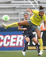 Sarah Huffman #14 of the Washington Freedom sends a long ball past Estelle Johnson #24 of the Philadelphia Independence during a WPS match on August 4 2010 at the Maryland Soccerplex, in Boyds, Maryland.Freedom won 2-0.