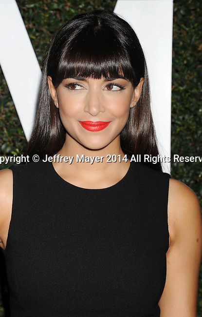 BEVERLY HILLS, CA- OCTOBER 02: Actress Hannah Simone arrives at the Michael Kors Hosts Launch Of Claiborne Swanson Frank's 'Young Hollywood' Portrait Book at a private residence on October 2, 2014 in Beverly Hills, California.